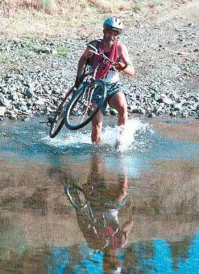 picture of Peter fording a stream in 1999 Rugged River Duathlon