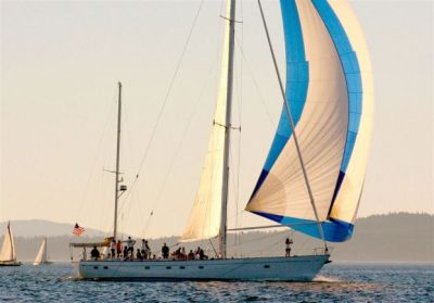 Atalanta under spinnaker on an evening cruise in the NW.
