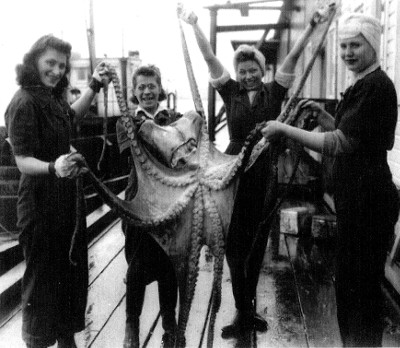 CRPA cannery ladies enjoy a break from work in the 1940's when a fishing boat brings in an octopus